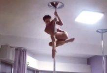 Danseuse pole dance sur sa barre